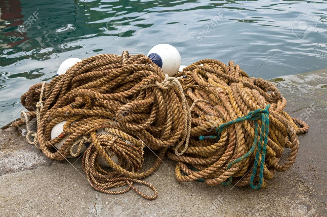 Big pile of ropes with floats to tie boats and used in fishing