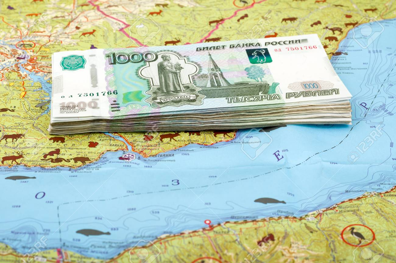 A stack of 1000 ruble Russian bills on the map of Lake Baikal,.. on slavic russia map, ural mountains russia map, siberia russia map, lake ladoga russia map, volga river russia map, vladivostok russia map, lake balkhash russia map, mt. elbrus russia map, kalmykia russia map, caucasus mountains russia map, pechora river russia map, yamal peninsula russia map, tuva russia map, altai krai russia map, aral sea map, samarkand russia map, india russia map, novgorod russia map, north pole russia map,