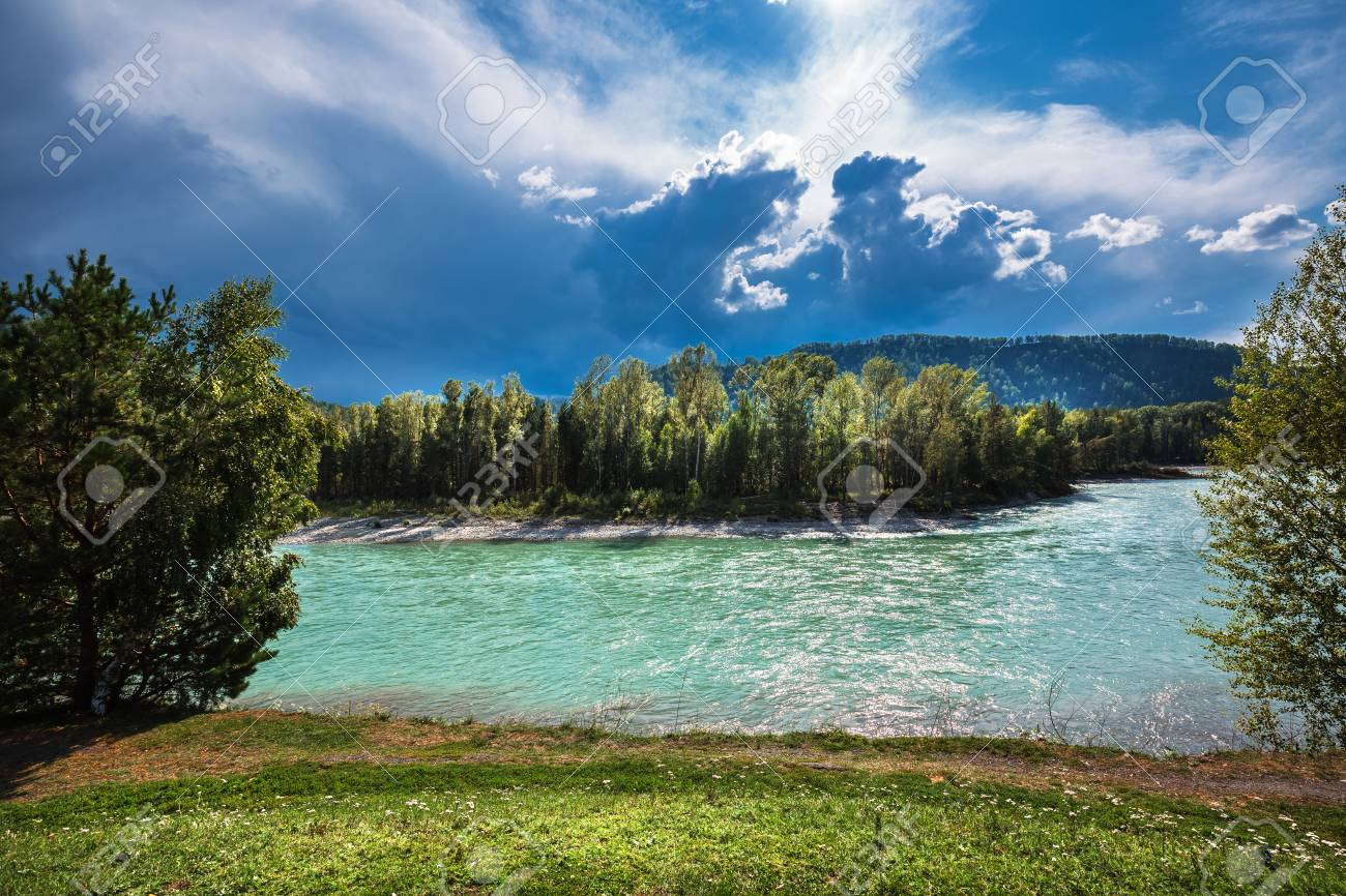 Turquoise waters of the Katun river against the mountains in summer. Mountain Altai, Southern Siberia, Russia - 107633919