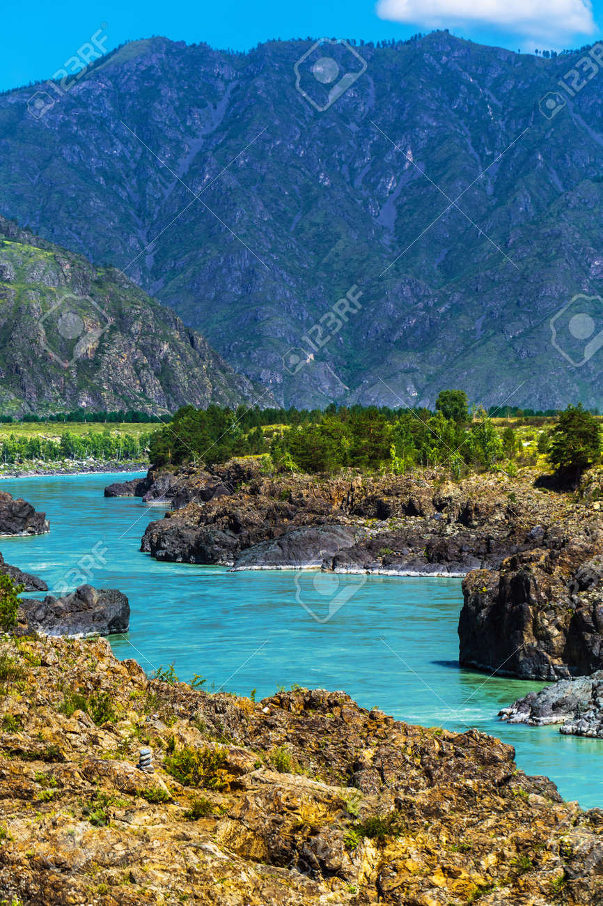 Chemal district, Altai Republic, southern Siberia, Russia - August 15, 2019: a view of the Katun river and rapids Teldekpen have Oroktoysky bridge - 129773590