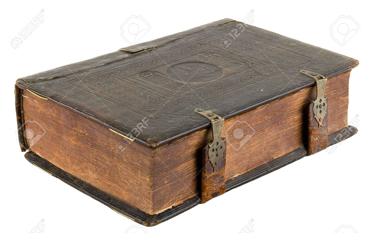 The ancient book in leather reliure on a light background Stock Photo - 958730