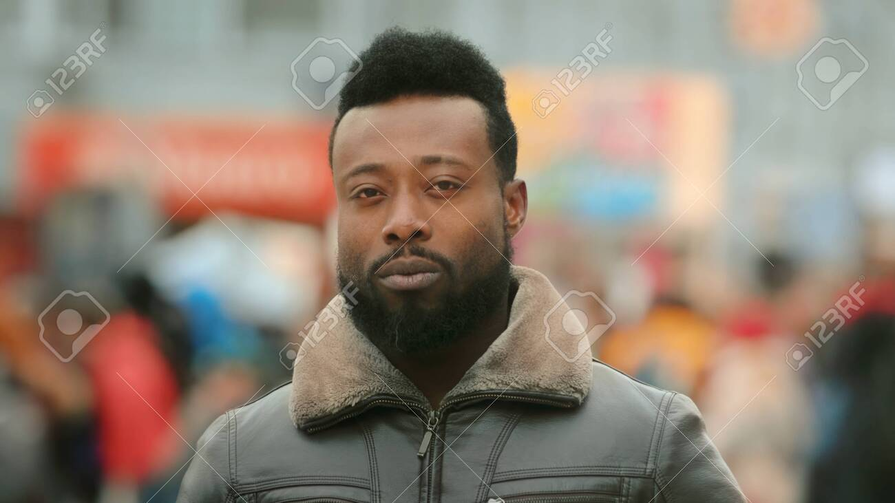 Close up African American man look camera stand street city. Black afro people face portrait closeup. Confident serious. Young adult guy. Urban background. George Floyd. Black lives matter. America. - 149650387