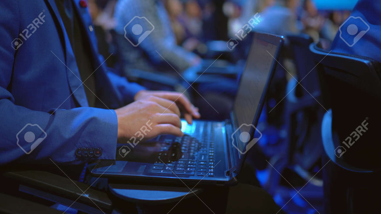 Person type keyboard crowded audience business forum. Viewer seminar listen speaker auditorium. Business man typing notebook political summit. Group people learning education speech in crowd audience - 157271887