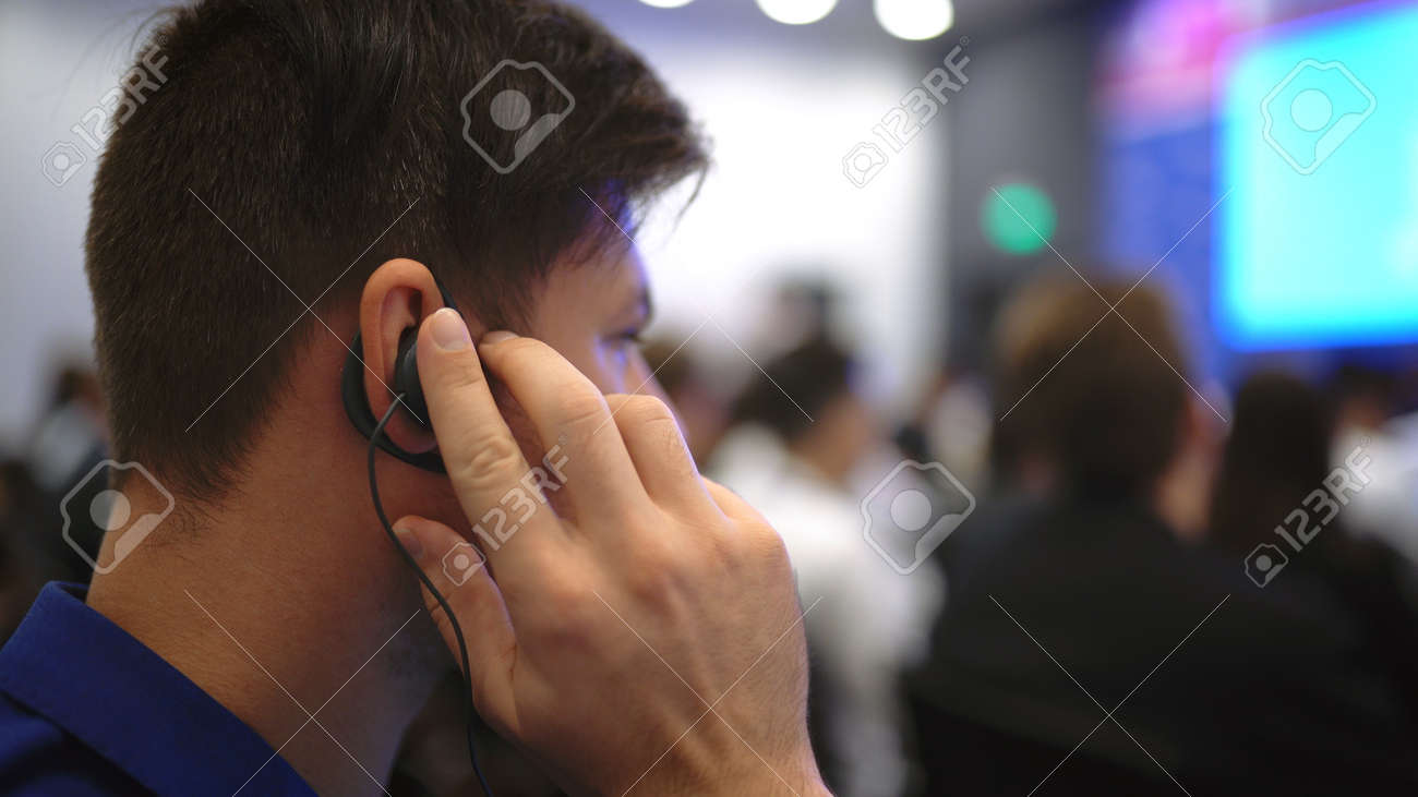 Audience business meeting crowded forum person. Viewer seminar listen earphone speaker auditorium. Event political summit business man spectator. Group people listening translate speech crowd audience - 157271896