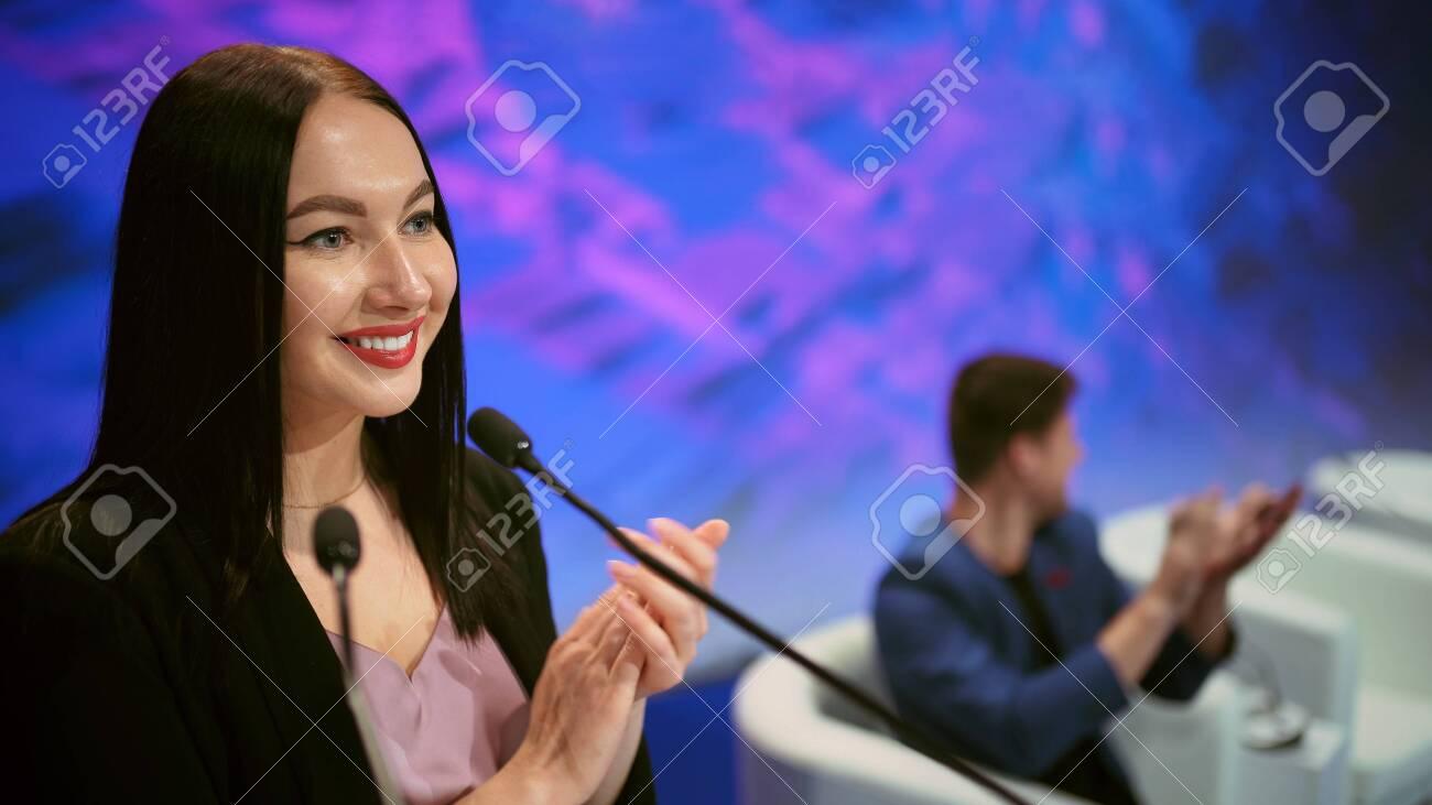 Speaker business meet talk audience from stage in microphone. Presenter economic forum speak public. Educational speech business woman. Speaker talking group people at summit. Presentation women. - 156059786