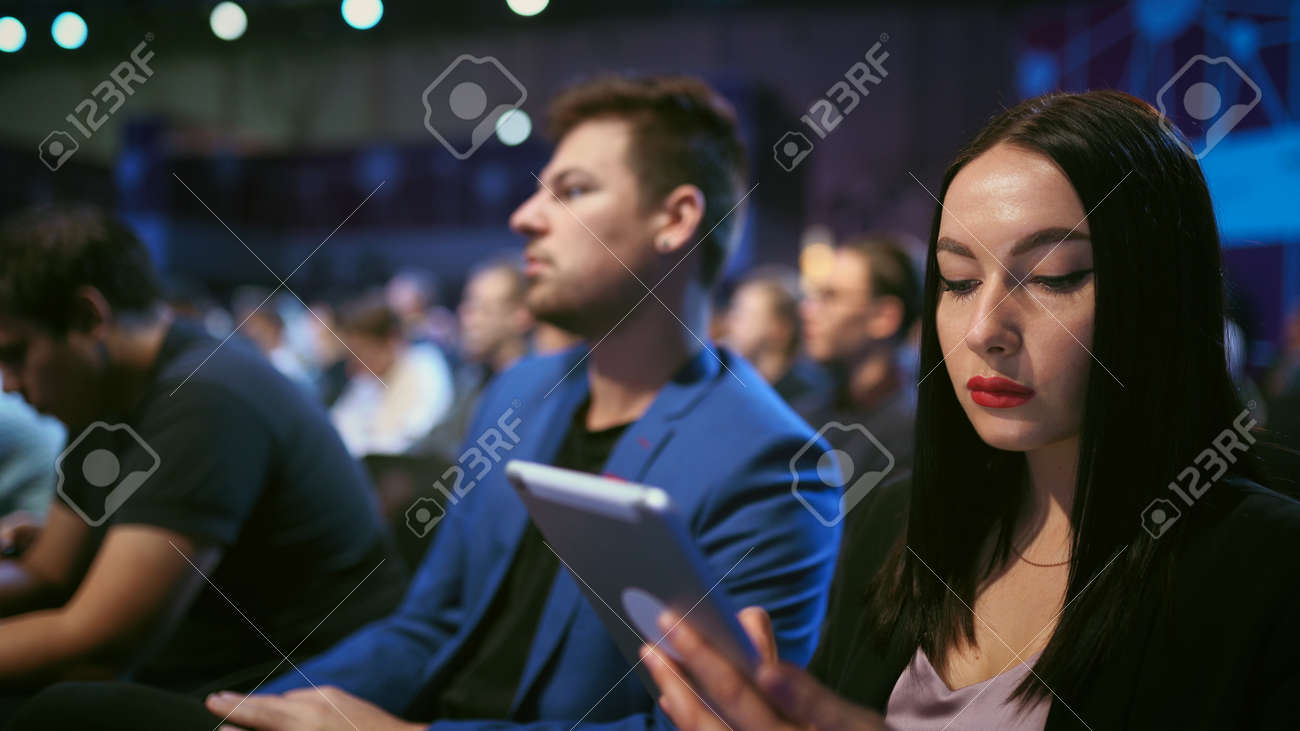 Business audience crowded forum. Persons serious discussion seminar. Woman and man listen speaker in auditorium. Viewer business men economic summit . Group people discussing speech in crowd audience. - 156059451