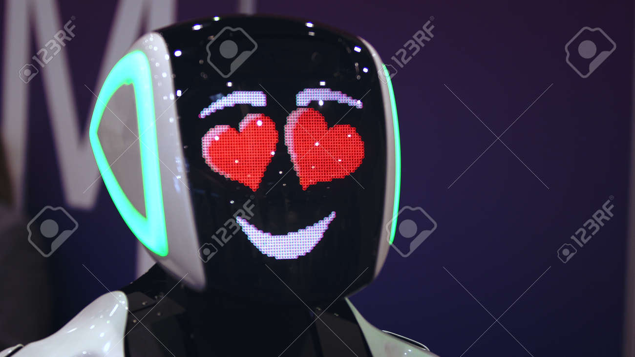 Beautiful portrait robot pulse heart on digital display pixel smile closeup looking at camera 4K. design sweet cyborg demonstrate 8 bit love. heart beat smiling android with feeling loving for people. - 160842079