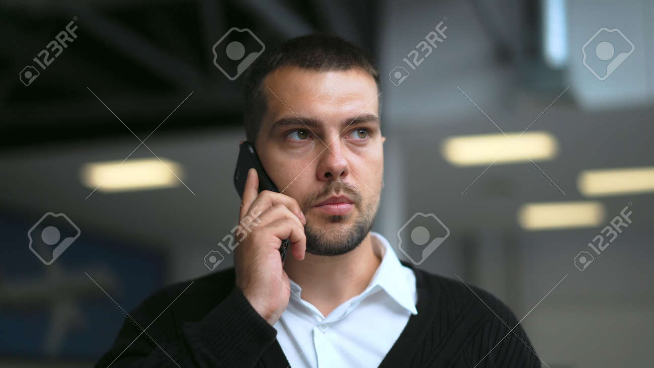 Successful white collar business man walking and talking on phone close up with serious face 4K. Business people speaking on mobile with partners. Manager walk and talk on phone with work colleagues. - 156422682