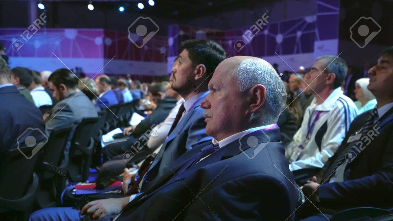 Russia, Novosibirsk, 21 sep, 2019: Crowd people listen speaker. Audience business meet forum. Auditorium viewer listen speaker. political summit business man. Group people listening speech crowd. - 156208846