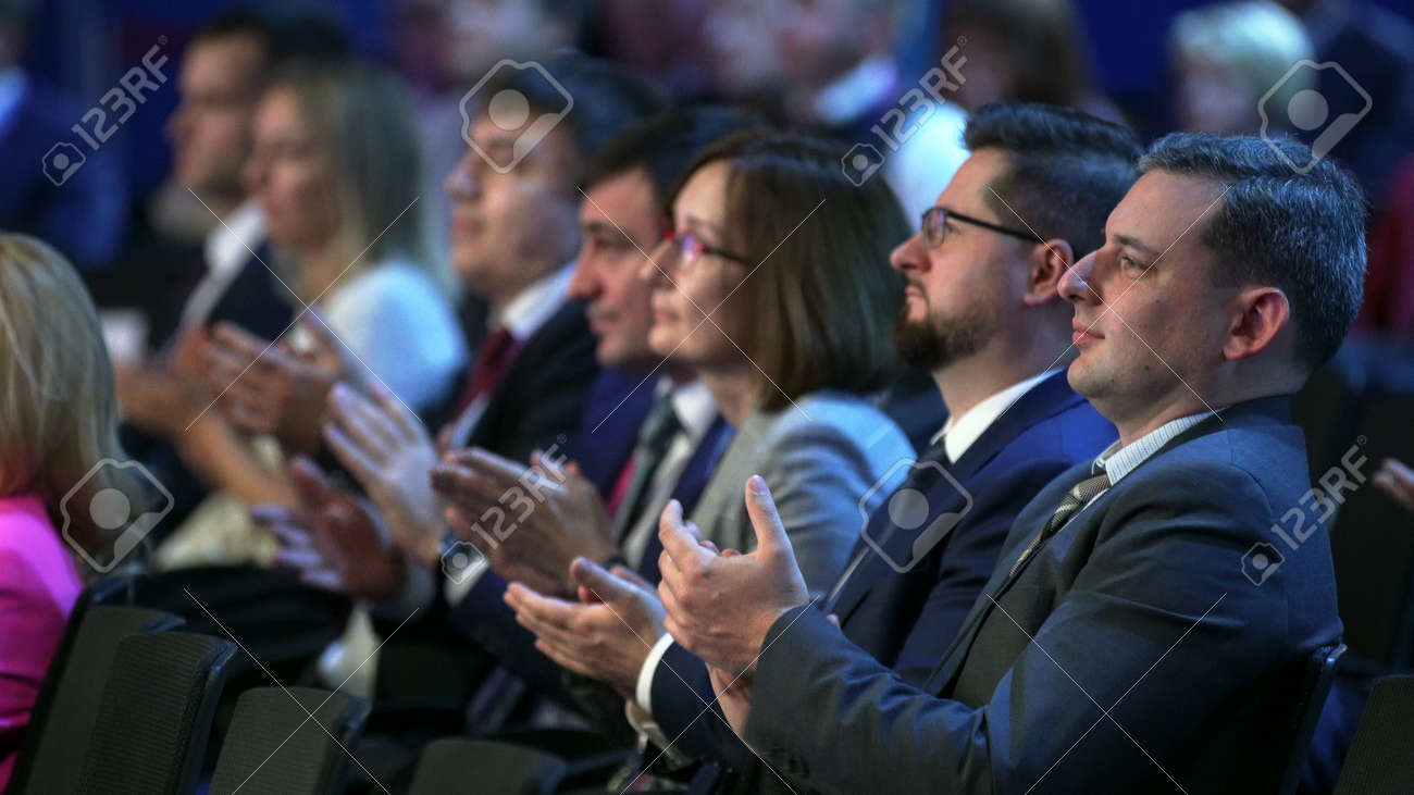 Russia, Novosibirsk, 21 sep, 2019: Crowd people listen speaker. Audience business meet forum. Auditorium viewer listen speaker. political summit business man. Group people listening speech crowd. - 156208842