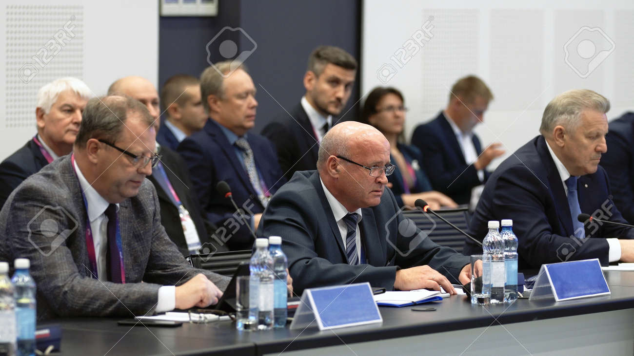 Russia, Novosibirsk, 21 sep, 2019: Speaker summit talk speech. Political discusses problems. Round table international nations. Politician talk in mic. Speech adult speaker at summit. Audience talking - 156208841