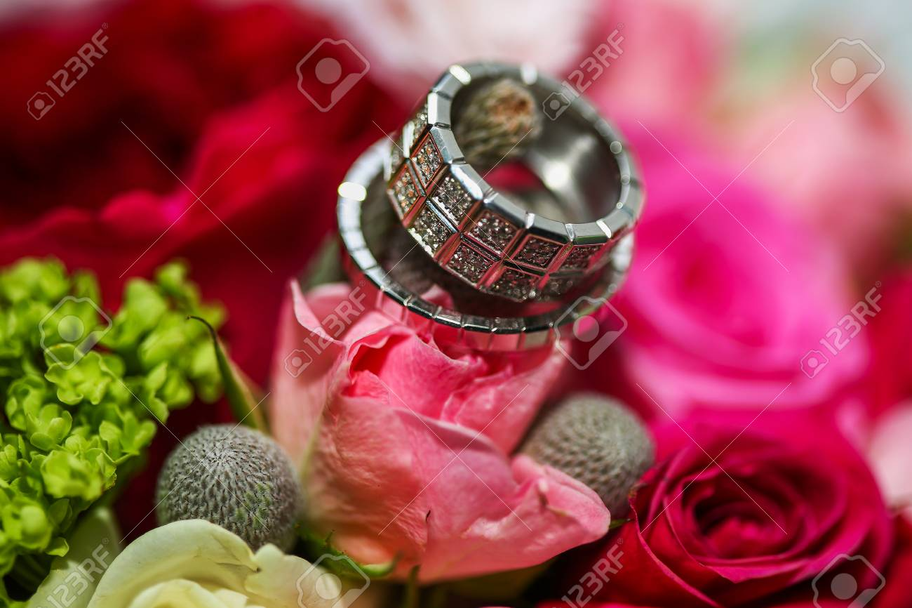 Beautiful Shiny Wedding Rings With Diamonds On The Pink Flowers ...