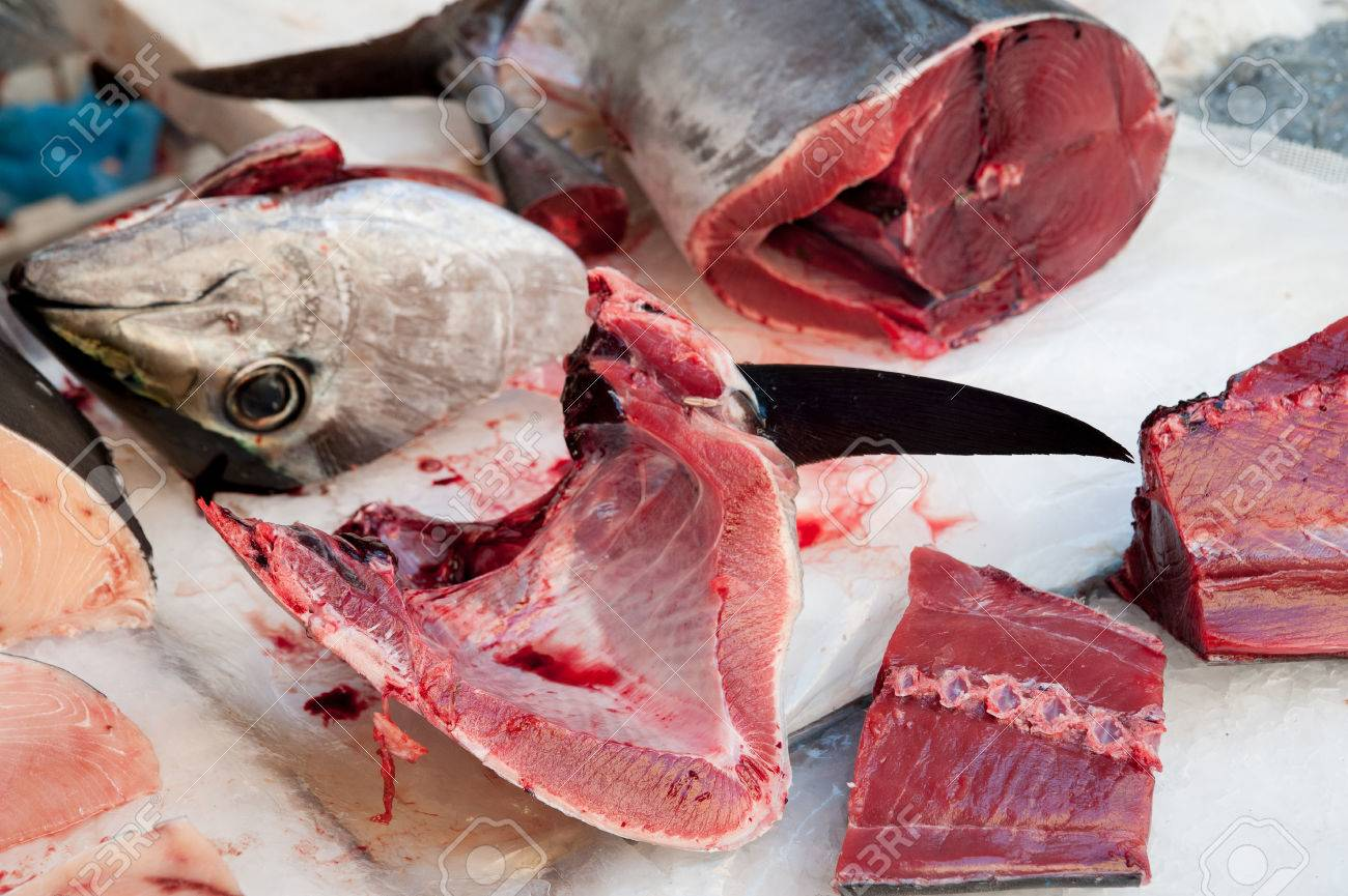 Cut Tuna Fish On The Table Of A Fish Seller In The Fishmarket ...