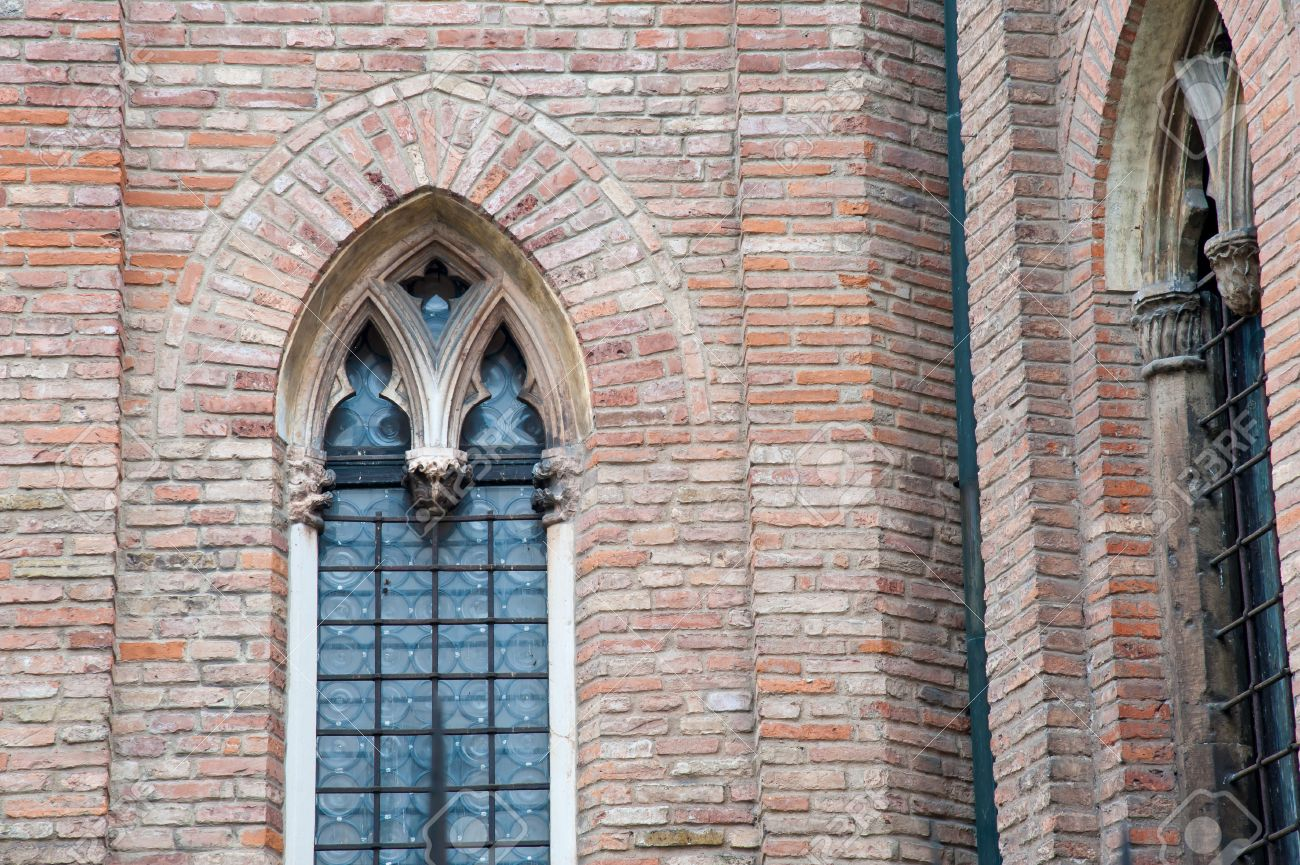 Pointed Arch Window In The External Sides Of Gothic Cathedral Vicenza Italy Stock