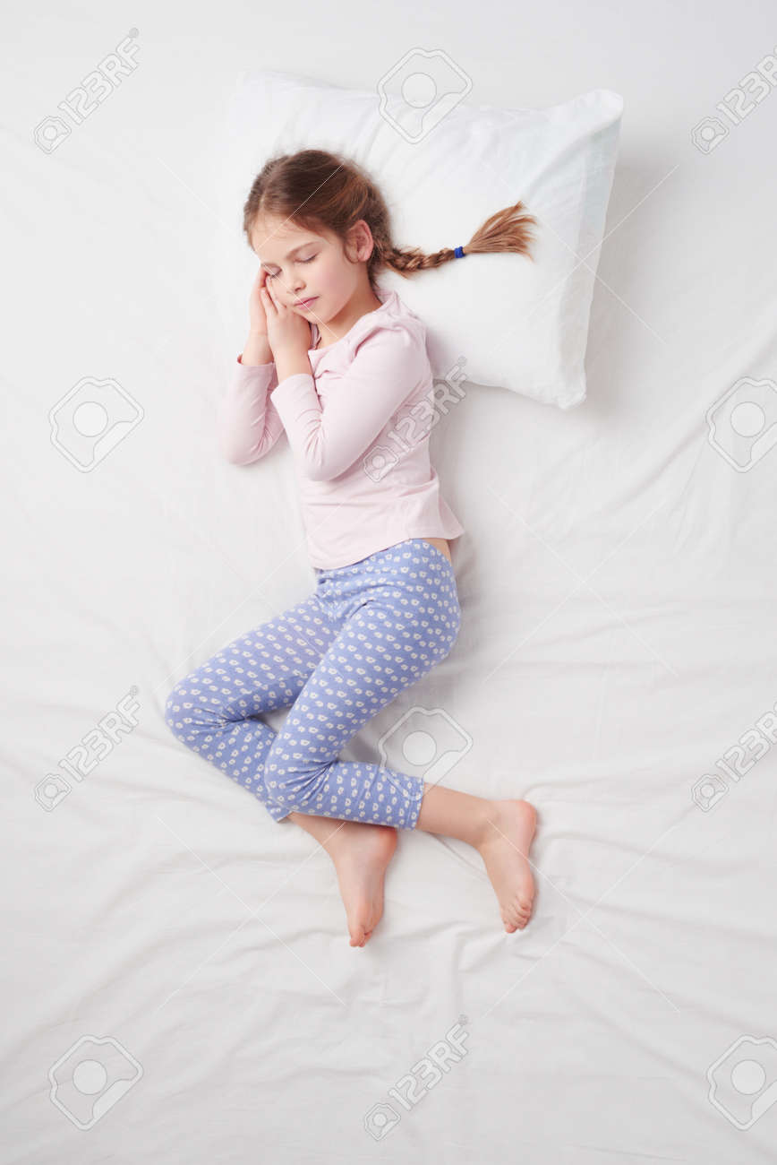 White bed top view - White Bed Top View Stock Photo Top View Photo Of Little Cute Girl With Pigtails