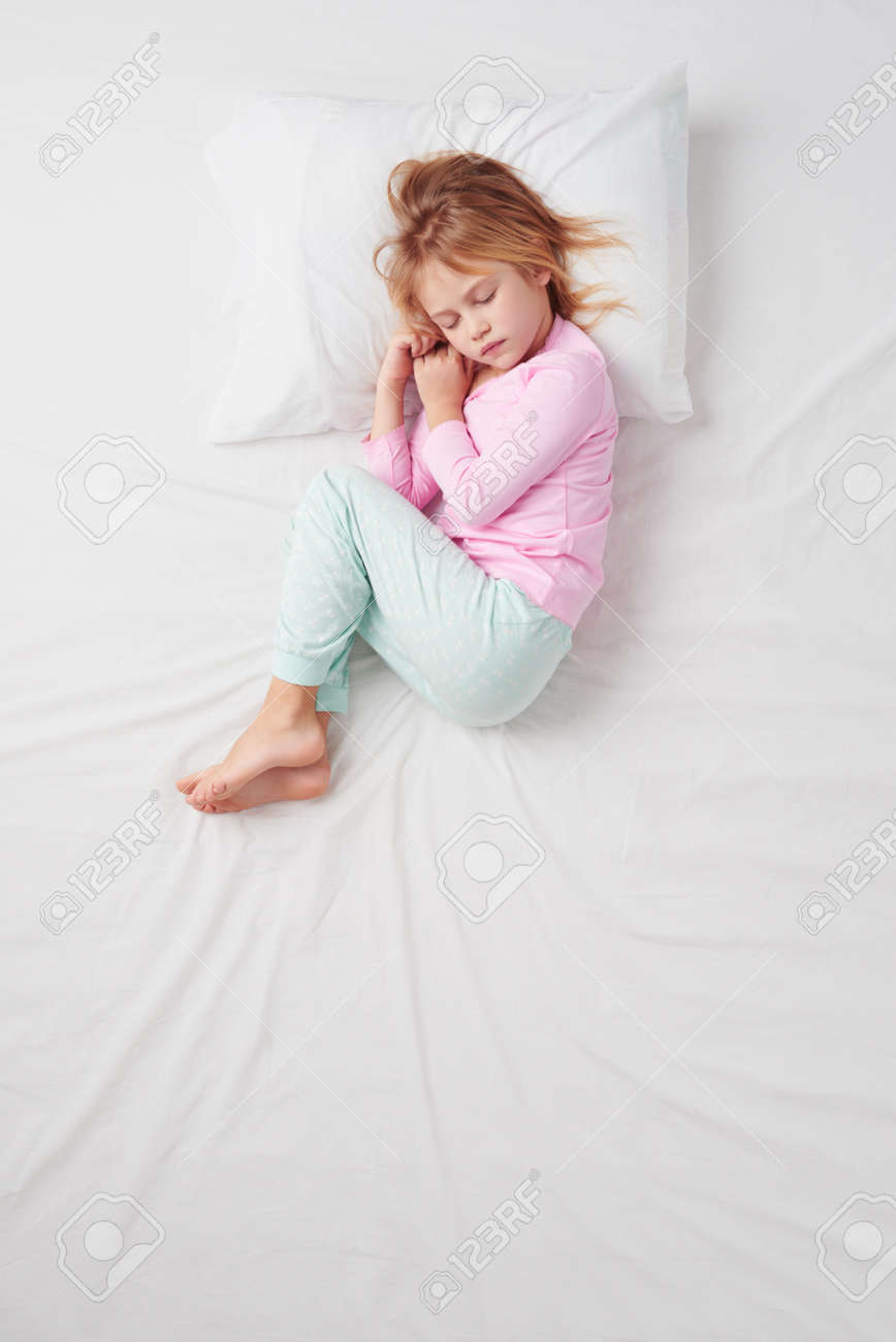 White bed top view - Stock Photo Top View Photo Of Little Girl Sleeping On White Bed