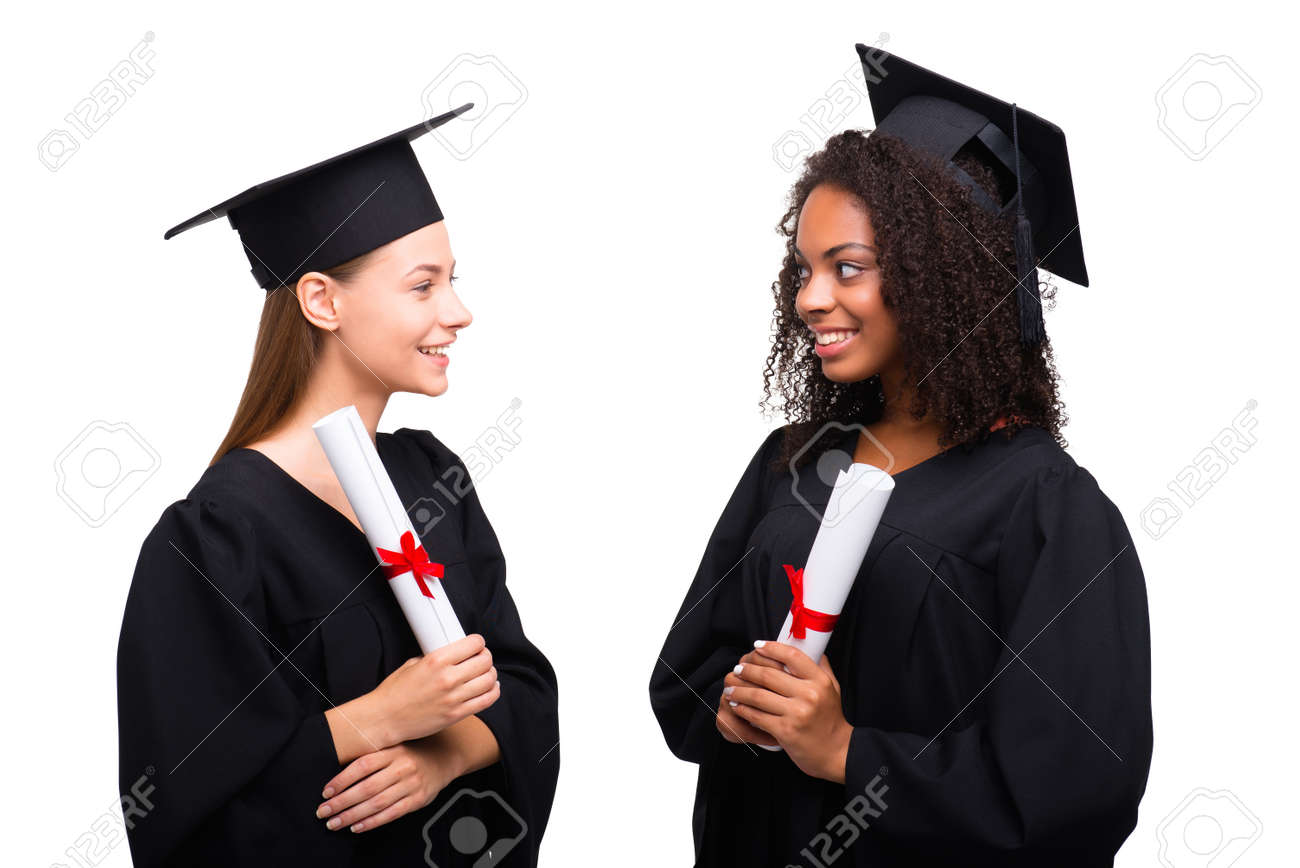 Two Young Student Girls Dressed In Black Graduation Gown. Isolated ...
