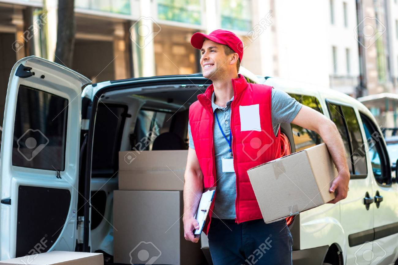Colorful picture of courier delivers package. Courier holding the box and smiling. - 44007116