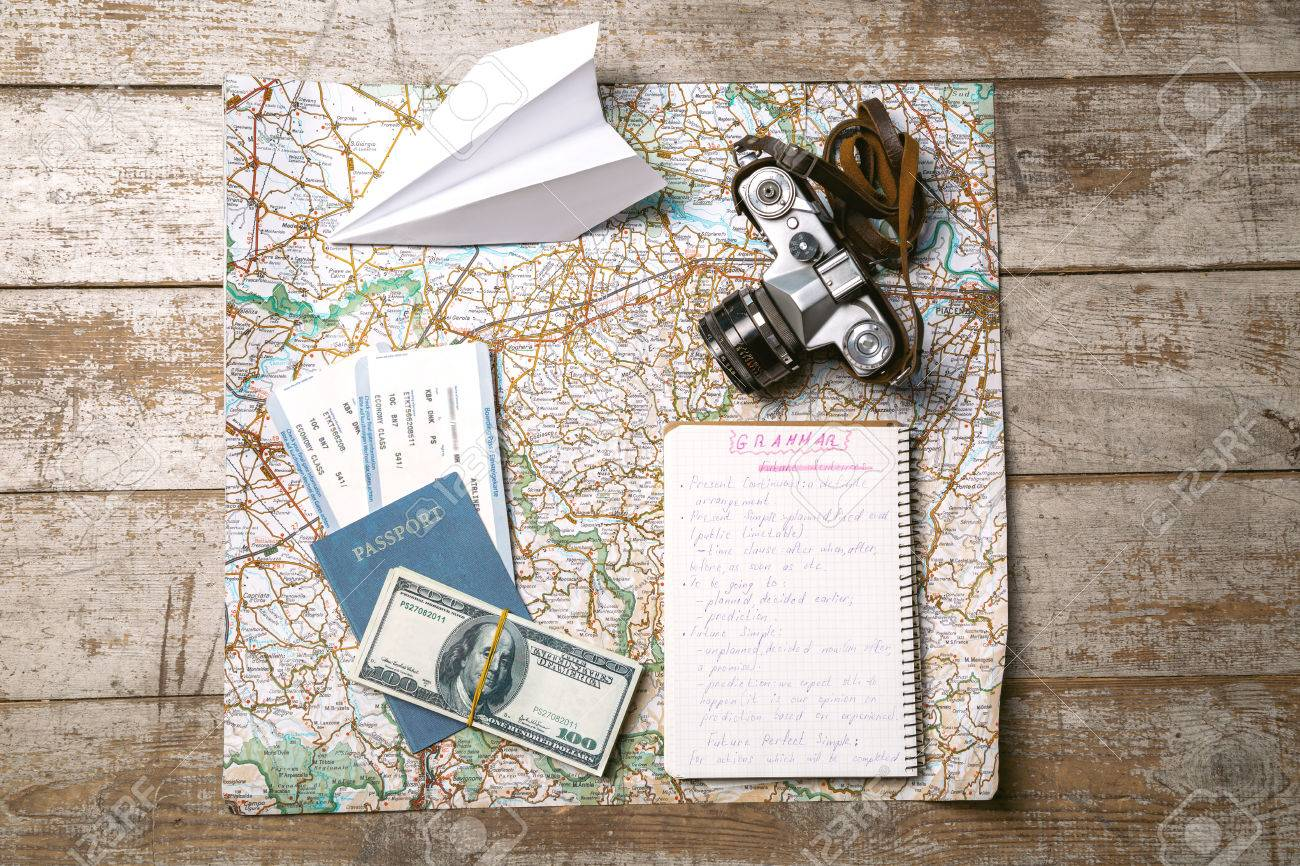 Top view photo of world map white paper plane passport tickets stock photo top view photo of world map white paper plane passport tickets money notebook and vintage camera objects are on light colored wooden gumiabroncs Choice Image