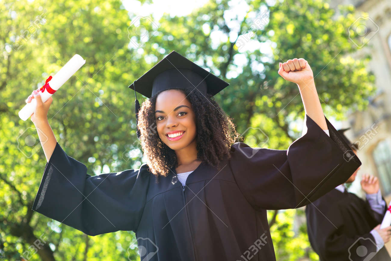 Young Afro American Female Student Dressed In Black Graduation ...