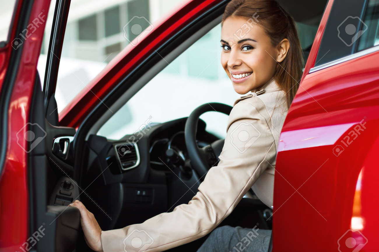 Photo of happy young mixed race woman sitting inside her new car. Concept for car rental Standard-Bild - 47713996