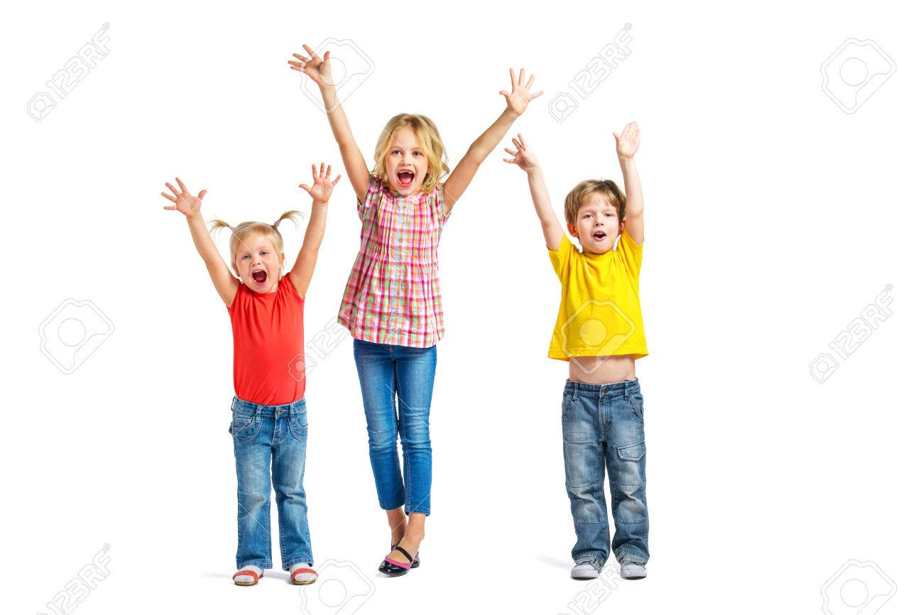 Colorful photo of little boy and cute little girls on white background. Children with hands up looking at camera and cheerfully screaming Standard-Bild - 49654394