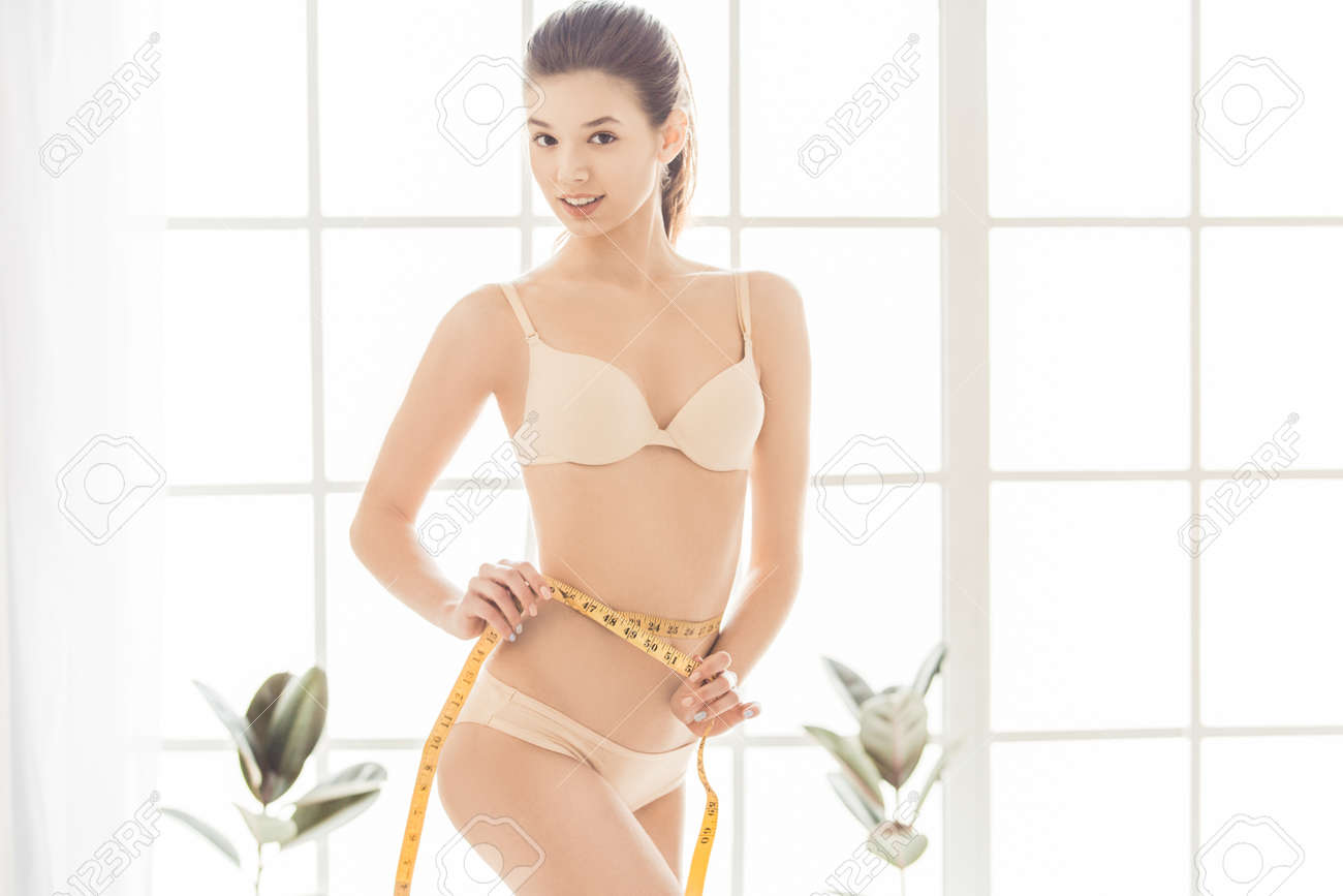 306d8fda74 Young woman weight loss perfect body shape Stock Photo - 81294922