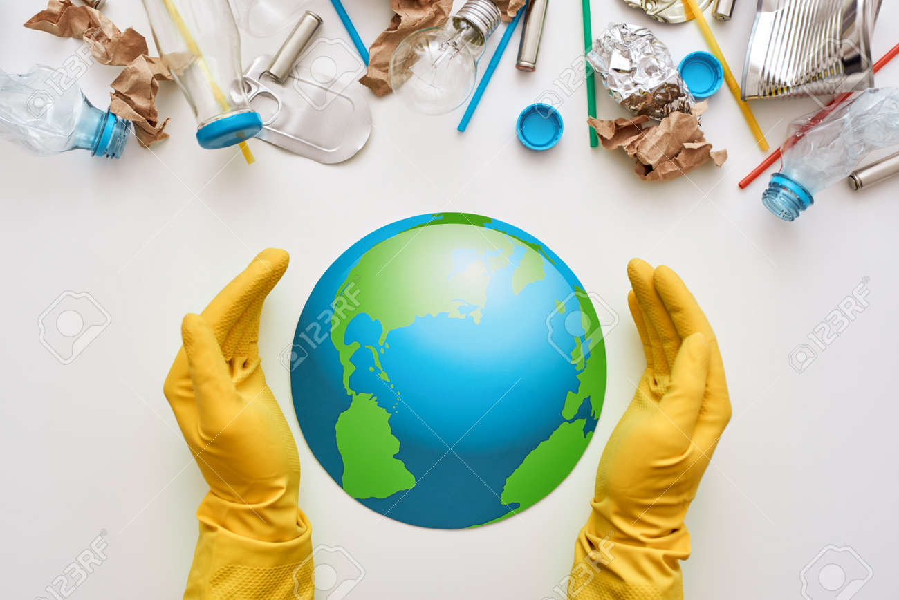 Protect the worlds ecology. Different types of garbage attacked the globe - 114019082