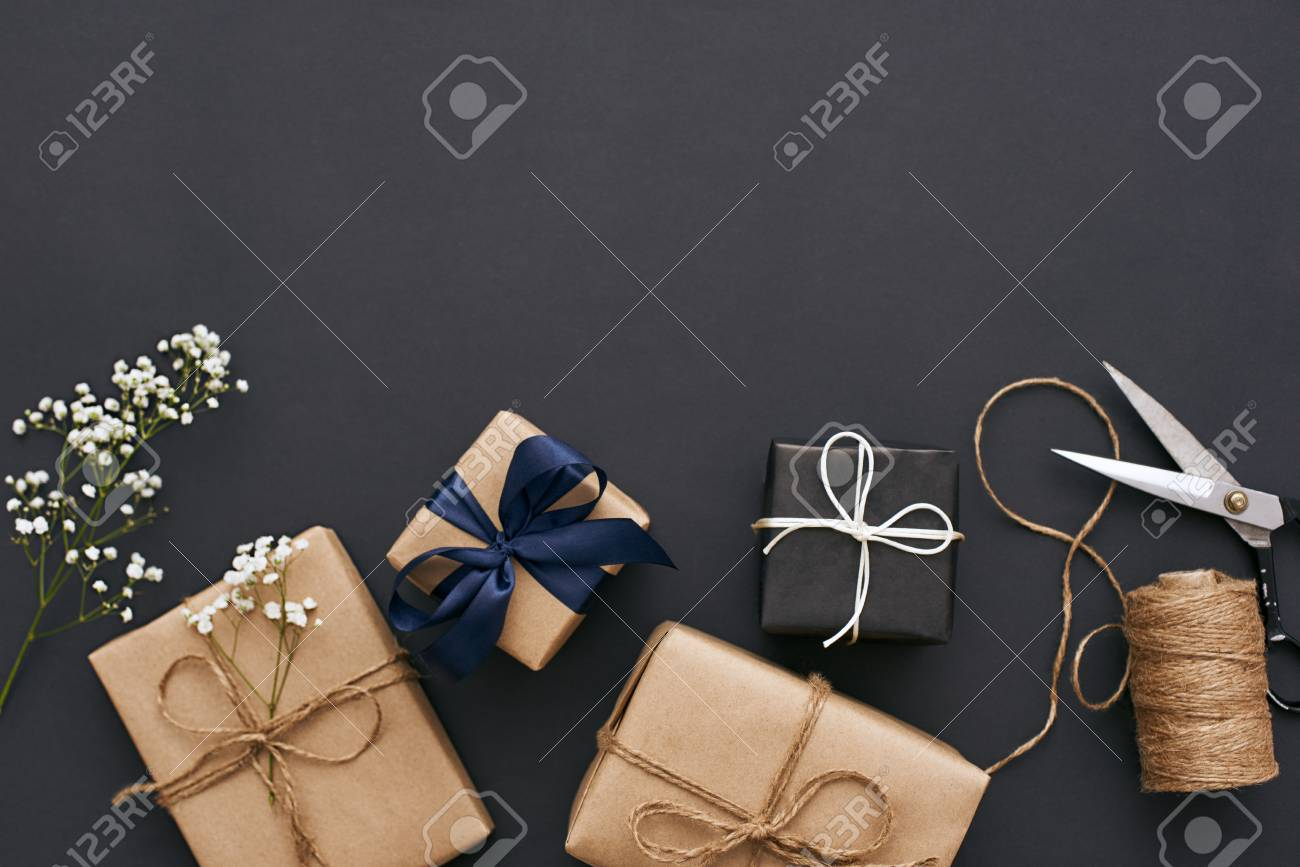 Preparing for holidays. Handmade gift boxes with beautiful decoration for friends - 117238312