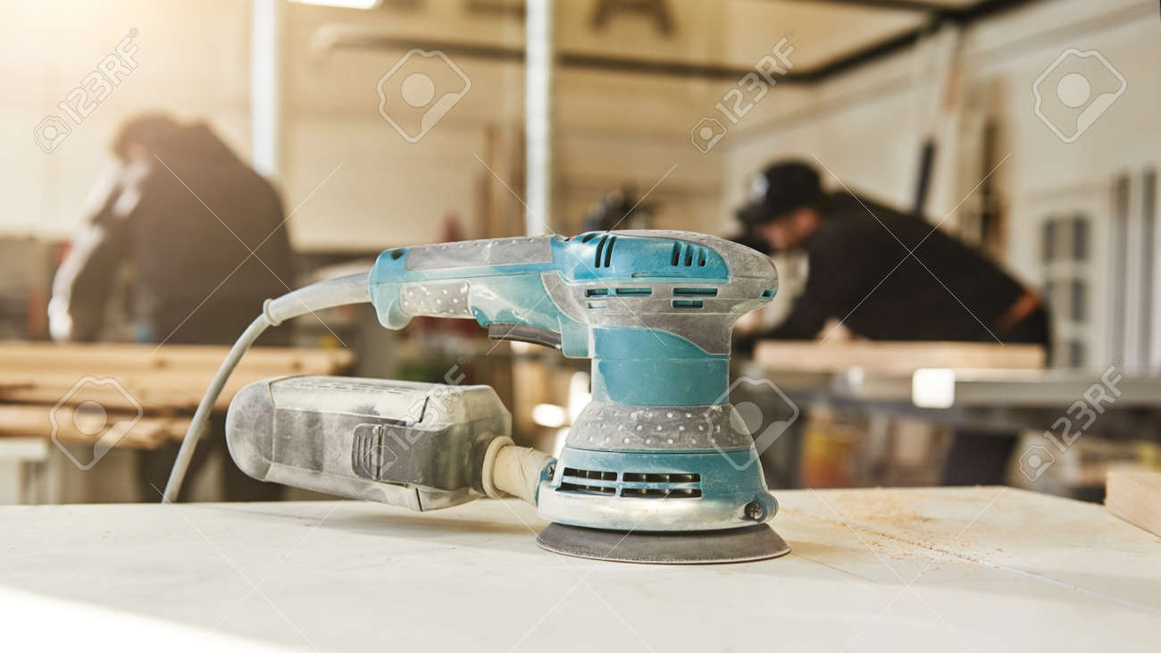 Woodworking with style. Close up of wood sanding machine - 124837681