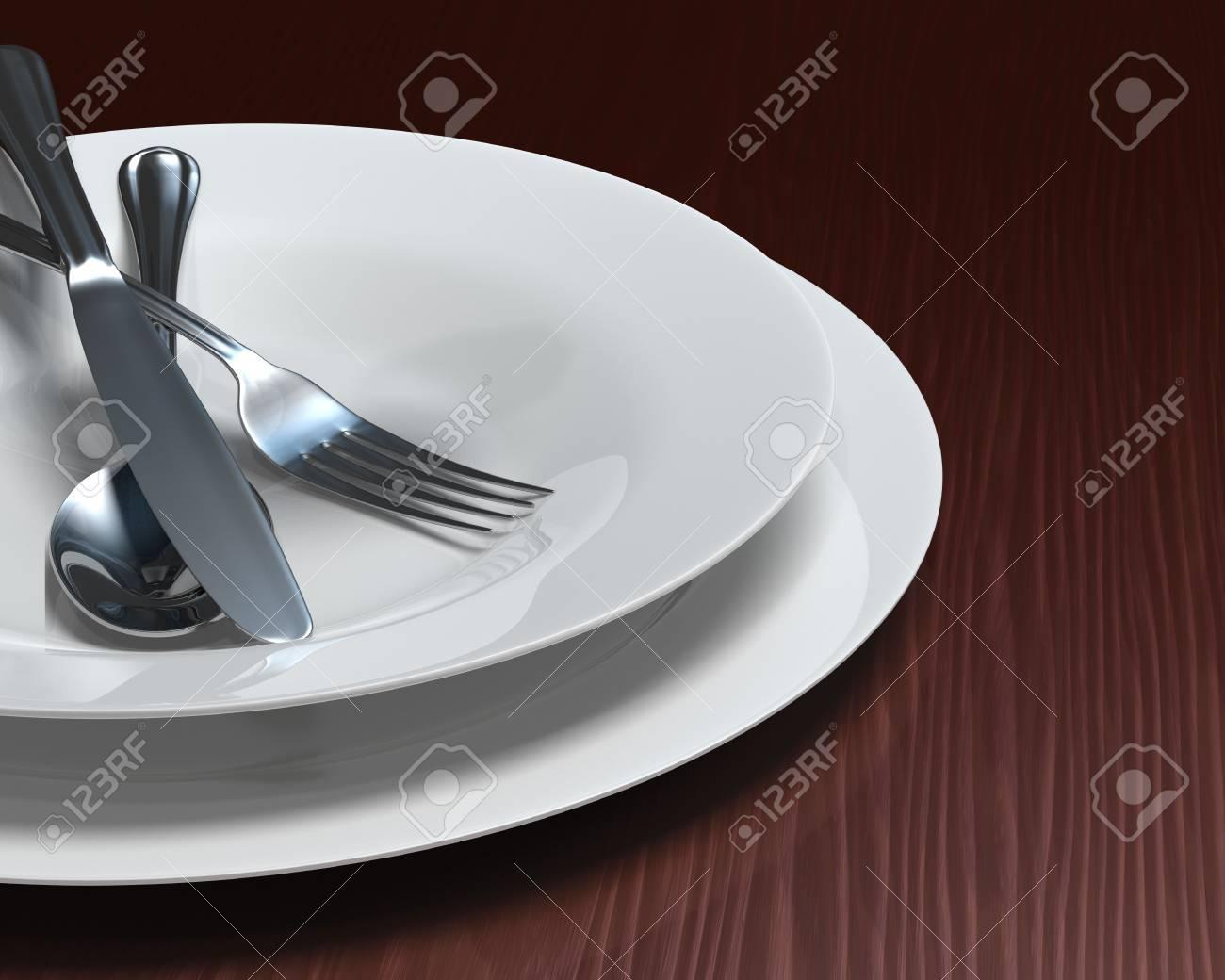 Plate and soup bowl with cutlery on rich, dark woodgrain surface. Stock Photo - 5865457