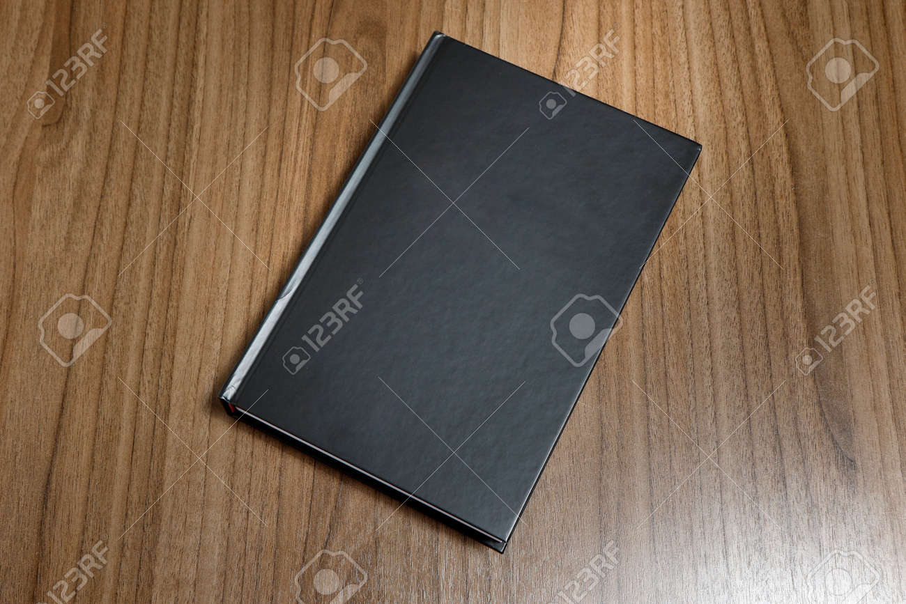 Black Hardcover Book On Flat Wood Surface Black Mock Up Book The