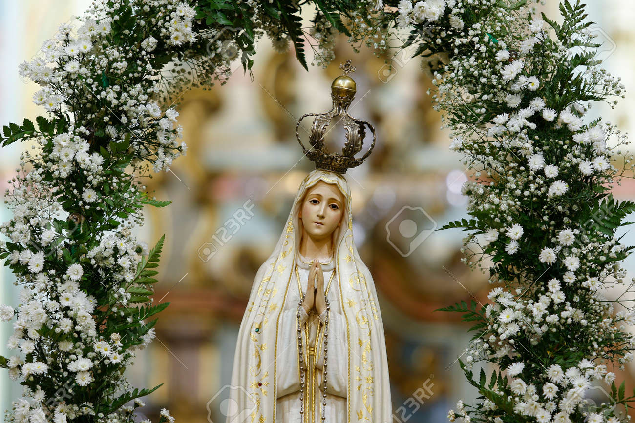 Statue of the image of Our Lady of Fatima, mother of God in the Catholic religion, Our Lady of the Rosary of Fatima, Virgin Mary - 122576792