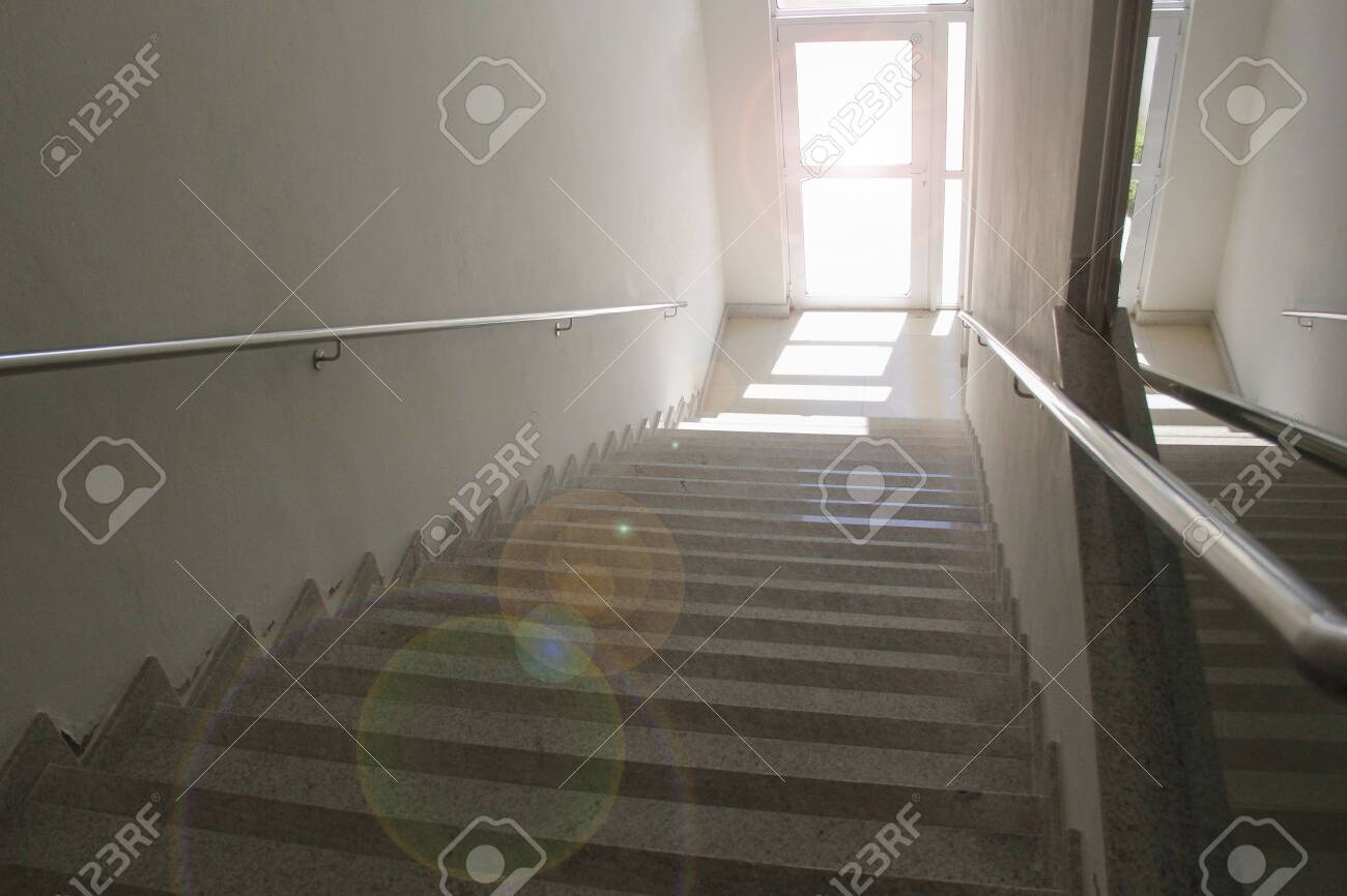 Stairway from top with clear door - concept of way forward - destination - direction to go - 131733822