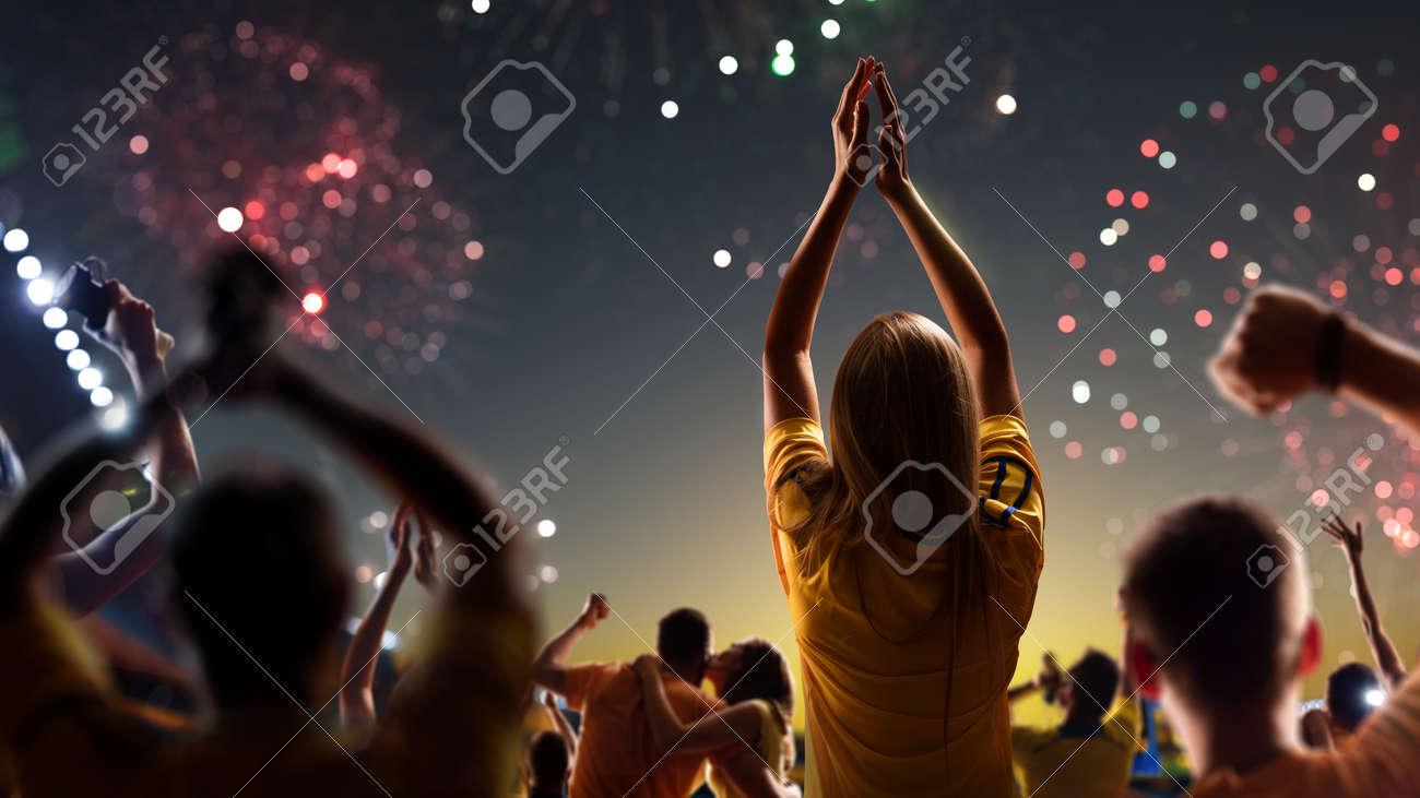Fans celebrate in Stadium Arena night fireworks - 157466900
