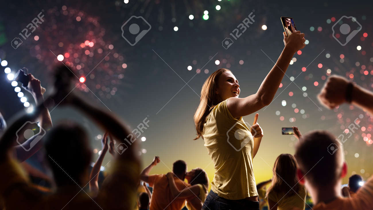 Fans celebrate in Stadium Arena night fireworks - 157466300