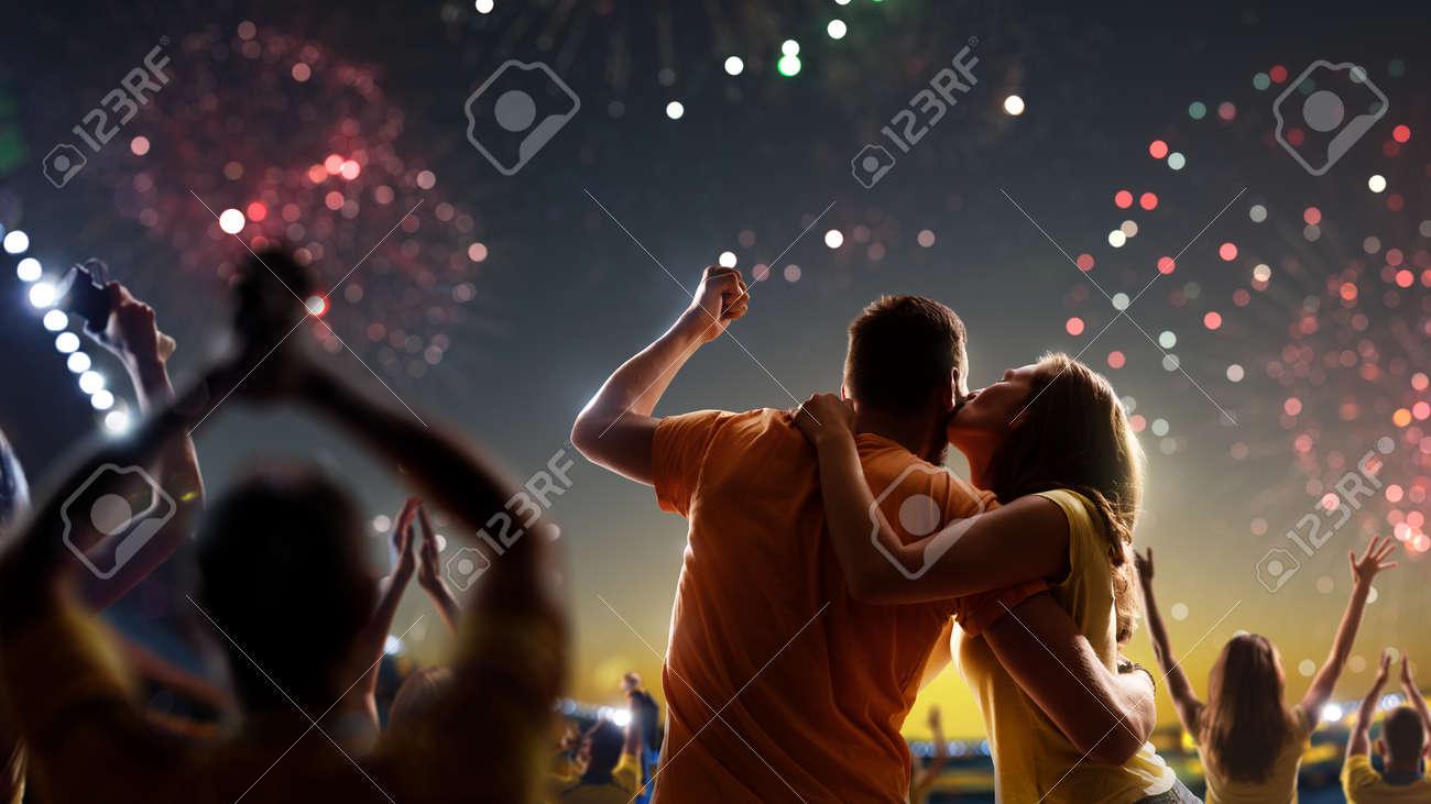 Fans celebrate in Stadium Arena night fireworks - 157252374