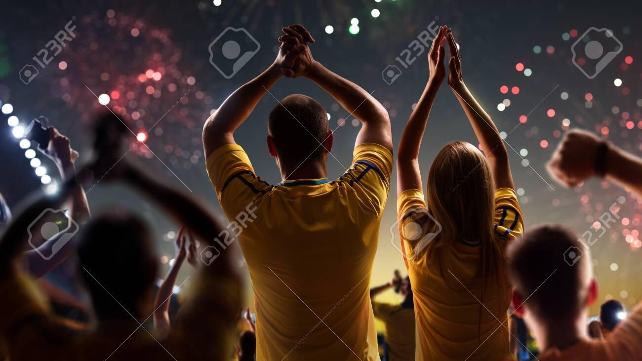 Fans celebrate in Stadium Arena night fireworks - 157292142
