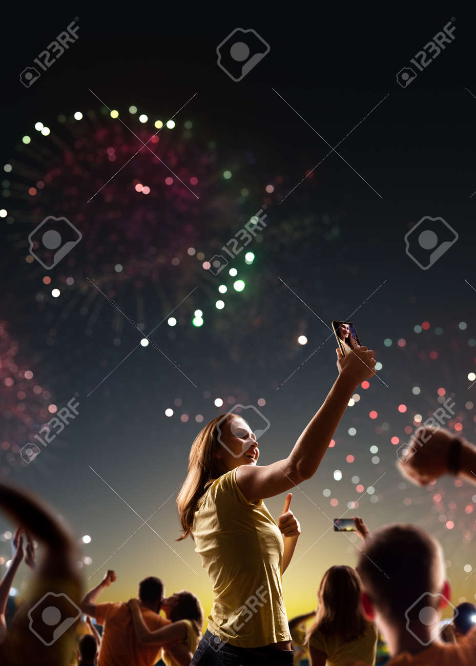 Fans celebrate in Stadium Arena night fireworks - 157291650
