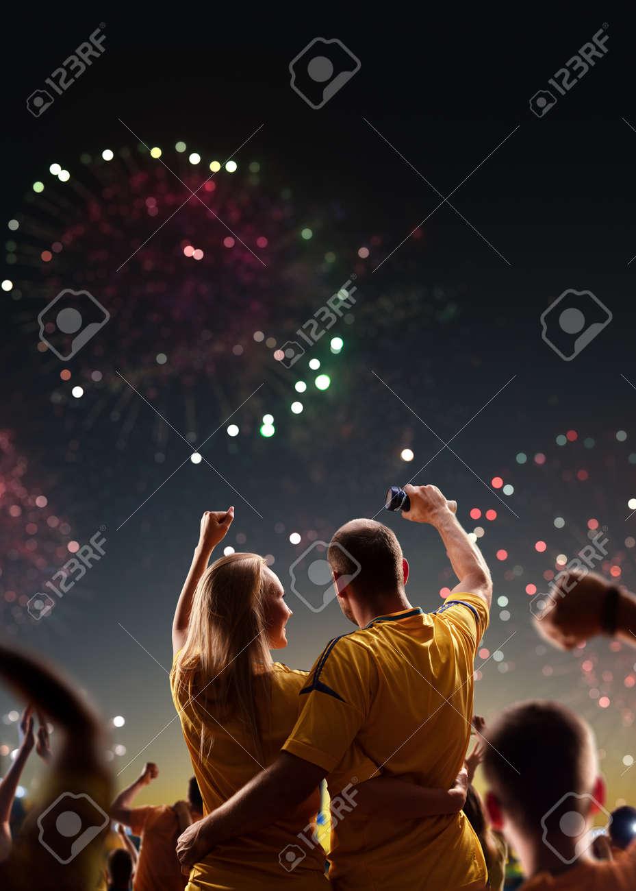 Fans celebrate in Stadium Arena night fireworks - 158199356