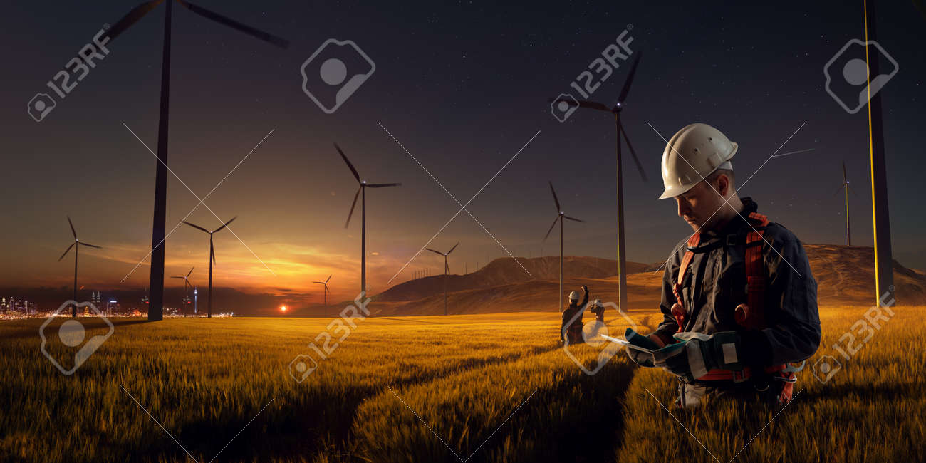 Happy engineer feel success after good work. He standing and looking beautiful sunset landscape - 158096885