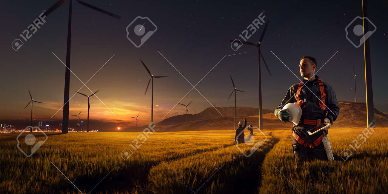Happy engineer feel success after good work. He standing and looking beautiful sunset landscape - 158096563