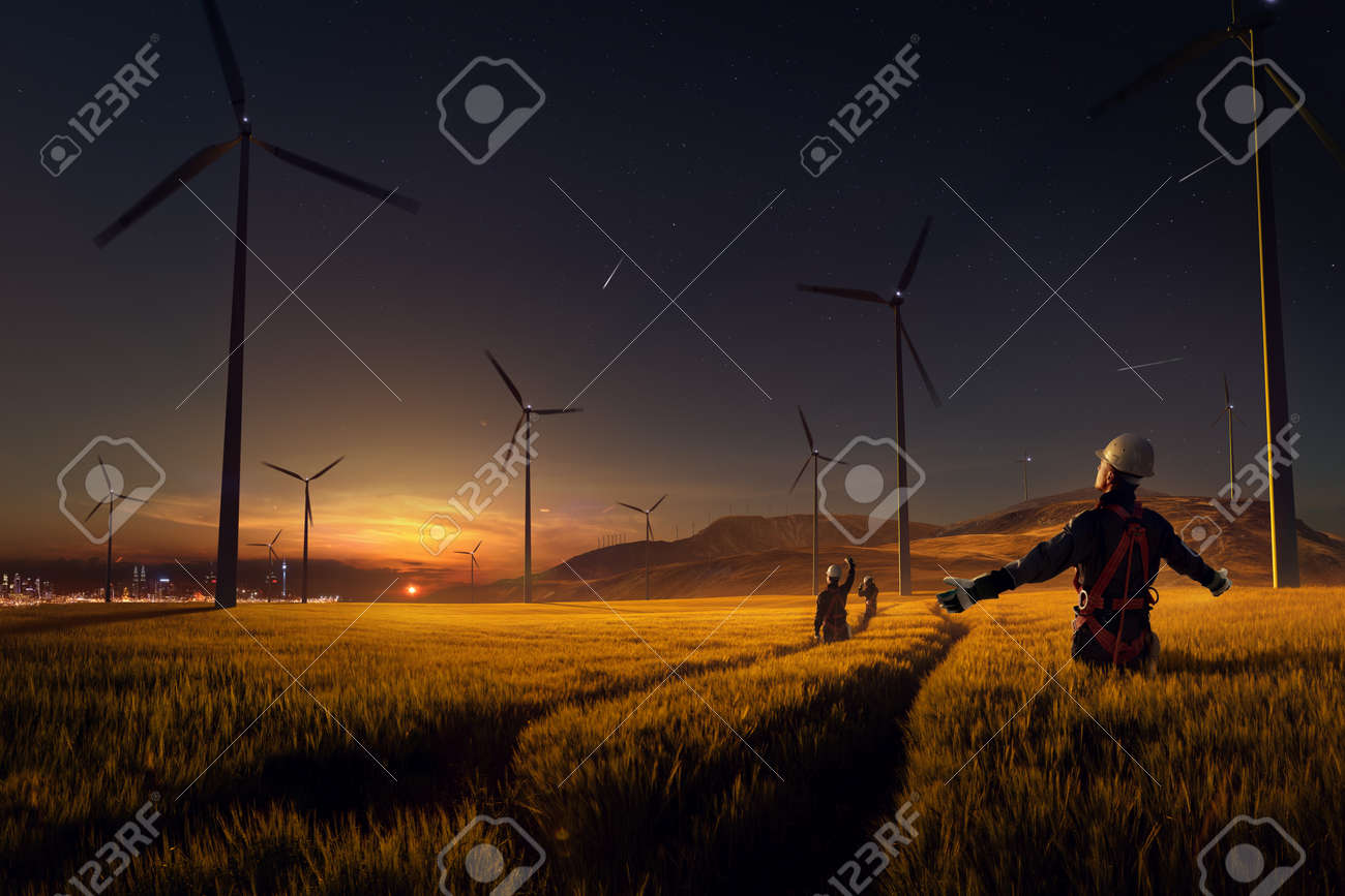 Happy engineer feel success after good work. He standing and looking beautiful sunset landscape - 158408516