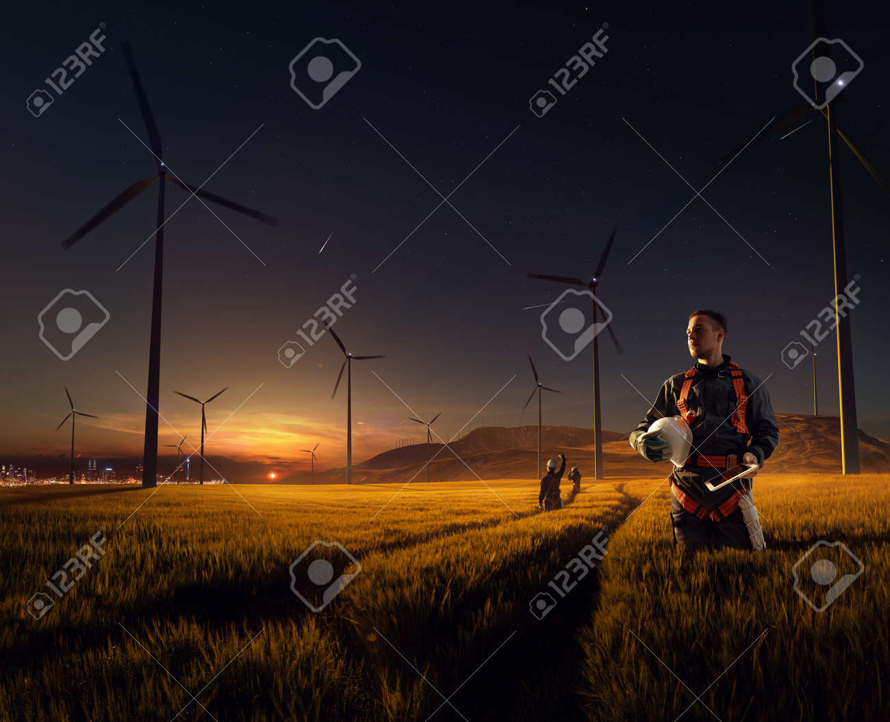 Happy engineer feel success after good work. He standing and looking beautiful sunset landscape - 158478011