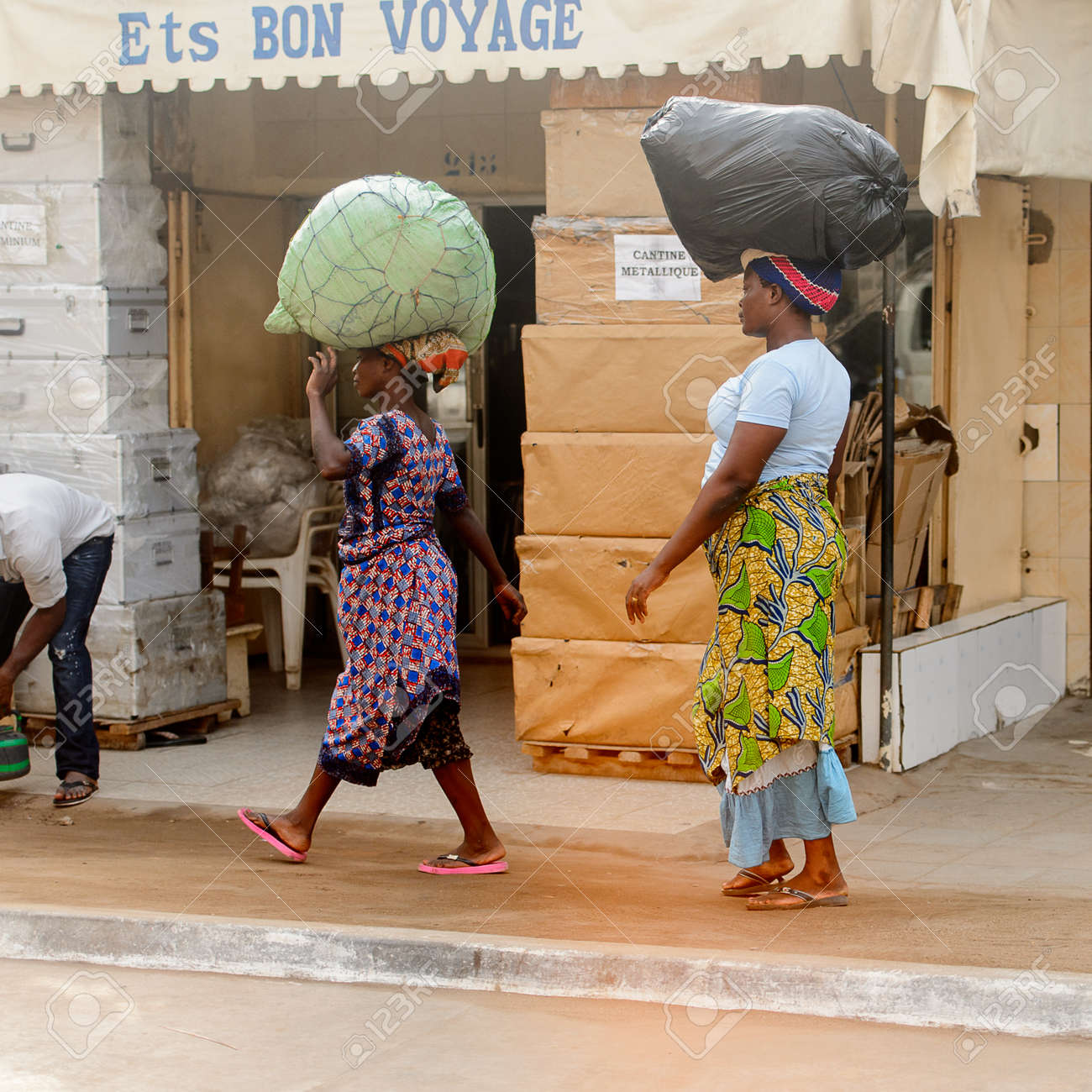 Cantine De Voyage Metallique lome, togo - jan 9, 2017: unidentified togolese woman carries..