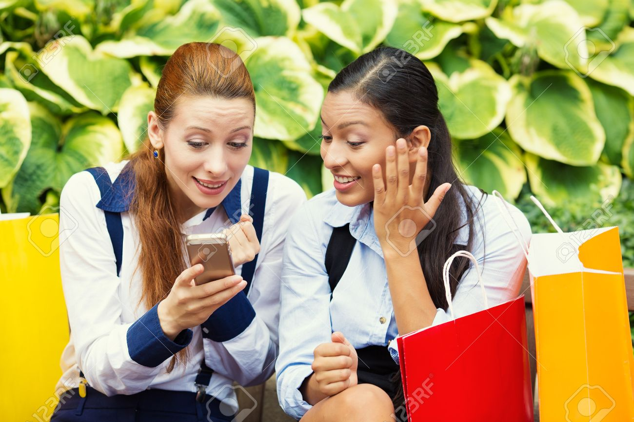 Image result for photo of two people looking at a smartphone