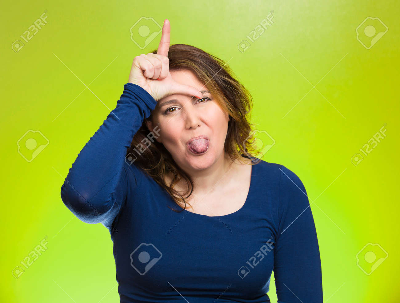 sticking tongue out body language