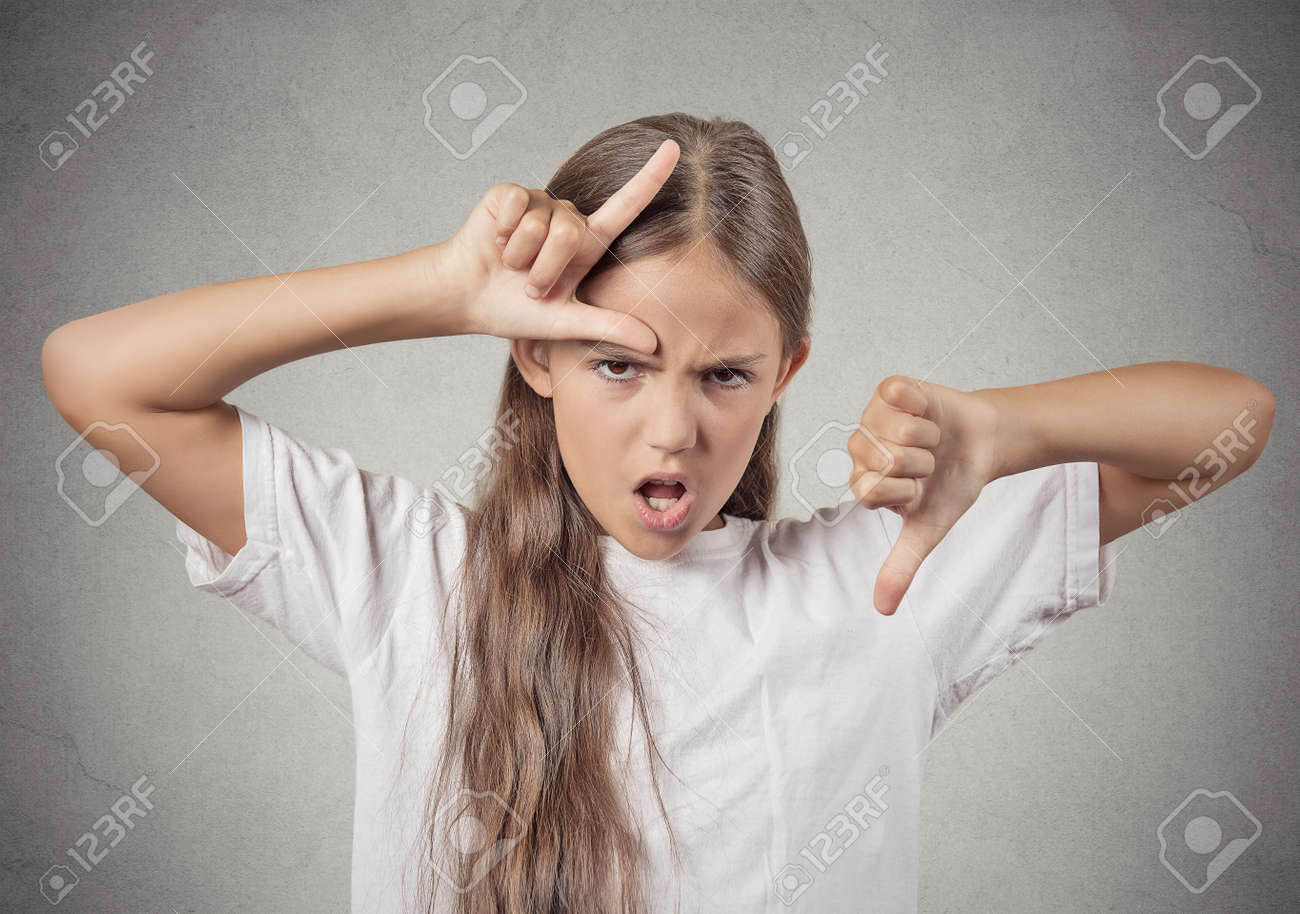 Closeup portrait angry mad upset pissed off teenager girl showing
