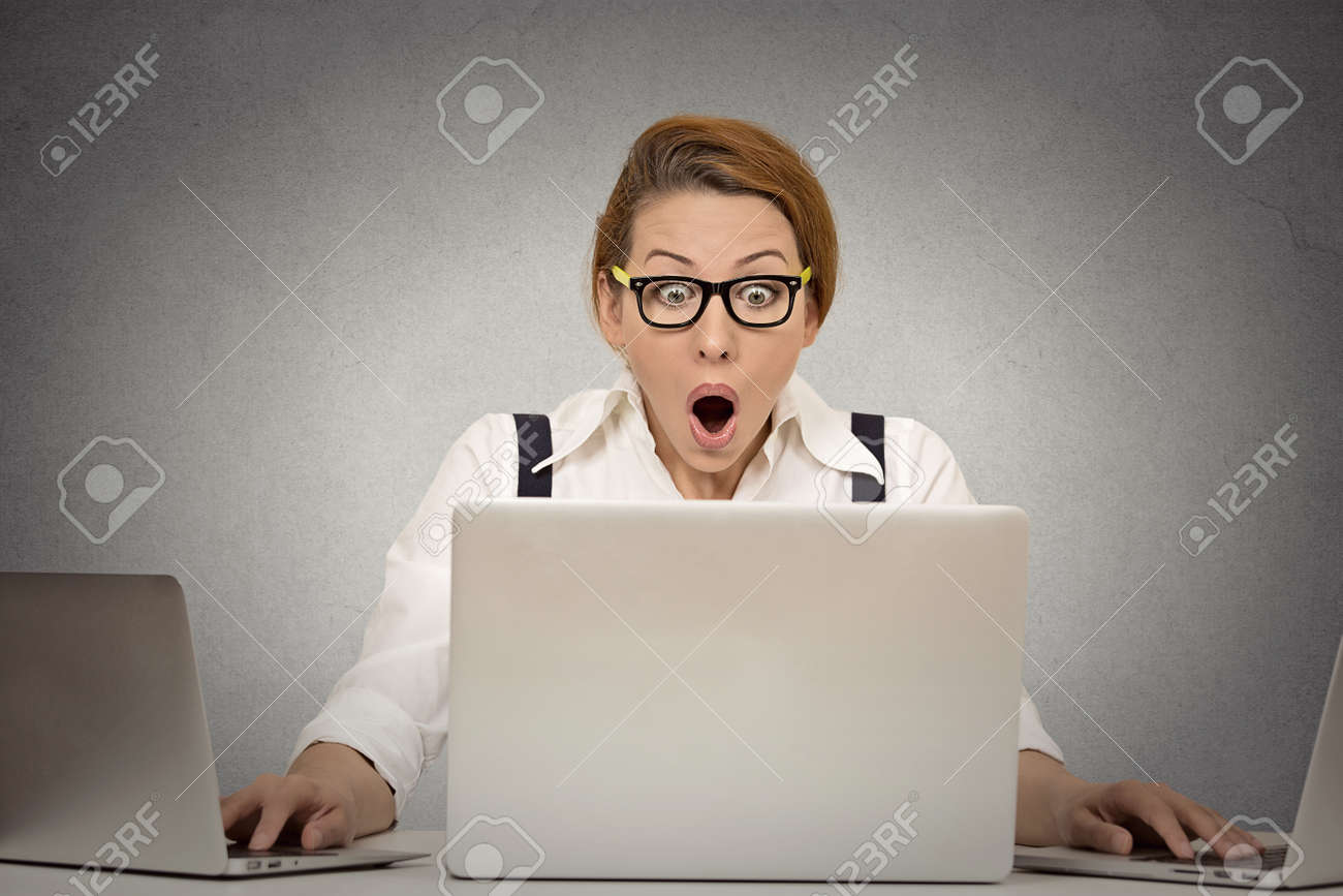 this is too much young w can t handle workload anymore stock photo this is too much young w can t handle workload anymore busy multitasking trying to manage it all by herself working on several computers