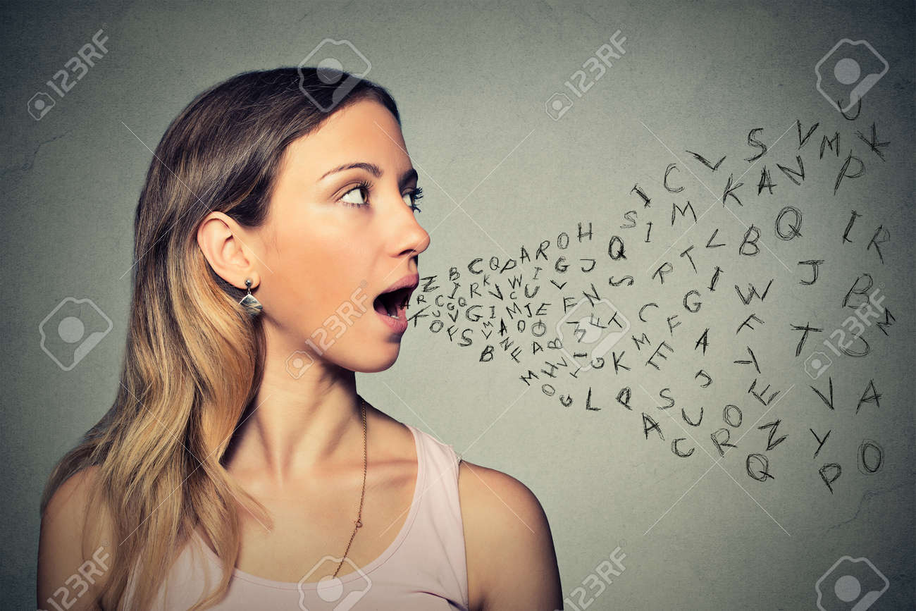 Woman talking with alphabet letters coming out of her mouth. Stock Photo - 42813617